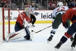 Minnesota Wild left wing Kevin Fiala (22) shoots against Washington Capitals goaltender Braden Holtby (70) during the first period of an NHL hockey game Friday, March 22, 2019, in Washington. (AP Photo/Nick Wass)