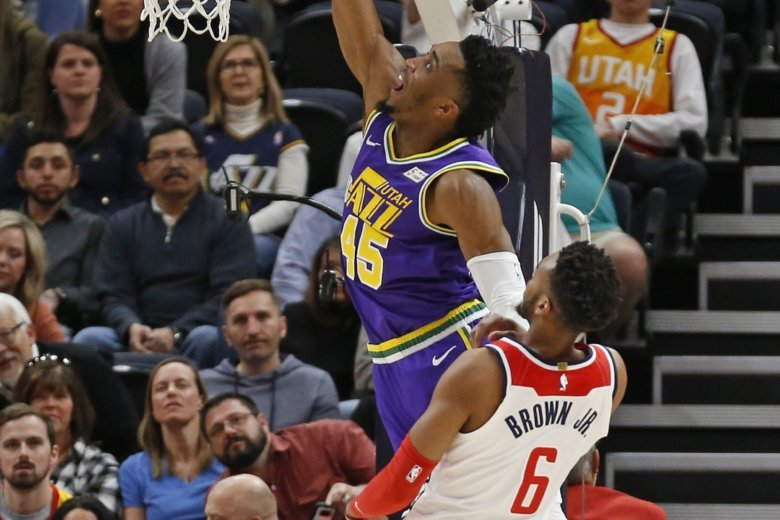 cbc2b2caf78b Utah Jazz guard Donovan Mitchell (45) goes to the basket as Washington  Wizards forward Troy Brown Jr. (6) defends during the first half of an NBA.