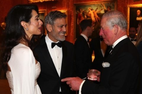 George and Amal Clooney attend charity dinner at Buckingham Palace