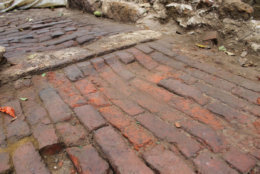 A brick floor at the Belvoir site that shows wear from people walking on it over the years. (Courtesy MDOT SHA)