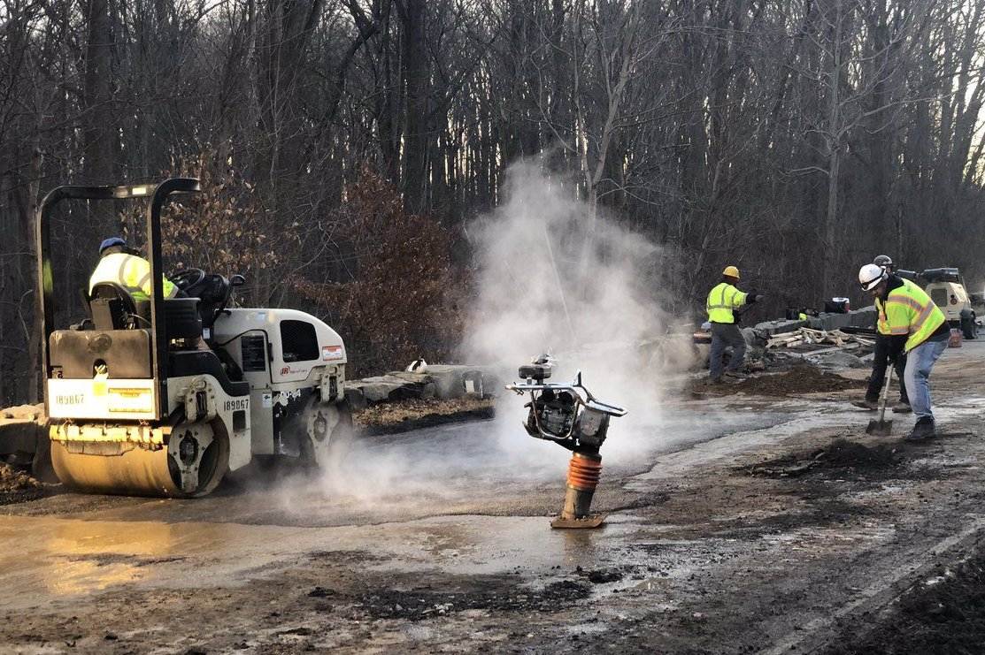 Work crews make repairs to damaged sections of the George Washington Parkway. (Courtesy National Park Service)