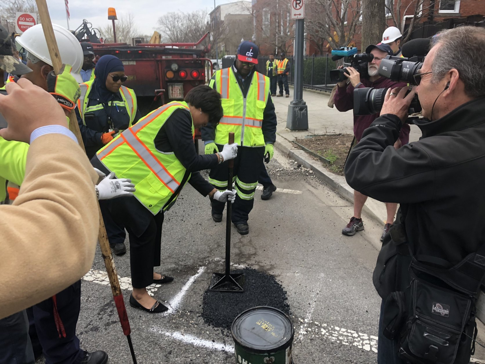 """We know that this is frustrating, and that's why our crews have been out working tirelessly since January filling as many potholes as possible,"" Bowser said. (WTOP/Max Smith)"