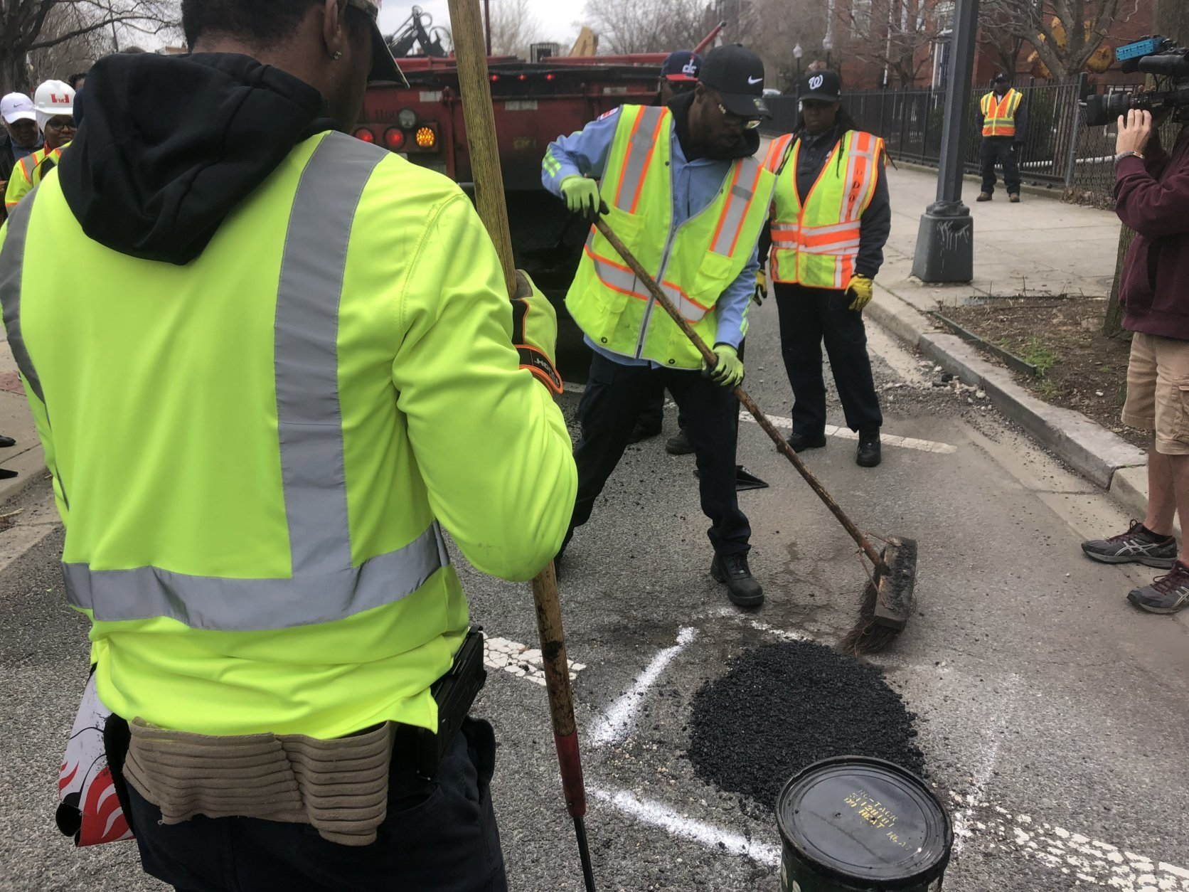 """The region has experienced record rainfall last year in 2018, which has created what looks like a record number of potholes,"" Mayor Muriel Bowser said. (WTOP/Max Smith)"