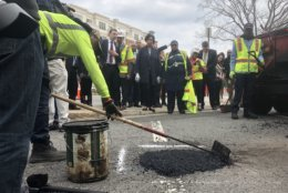 DDOT crews fill in a pothole in Northeast. (WTOP/Max Smith)