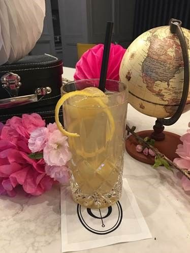 Opaline Bar & Brasserie is offering its Fleur de Cerisier cocktail, featuring Suntory Whisky Toki, Cherry Blossom tea, honey infused ice cubes and soda for $14. (Courtesy Opaline Bar & Brasserie)