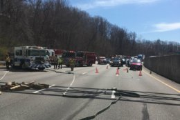 Crews clean up the crash site Thursday. (Courtesy Fairfax Fire and Rescue via Twitter)