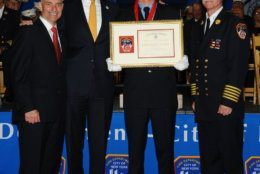 In 2014, New York mayor Bill de Blasio awarded Slutman with the Fire Chief's Association Memorial Medal after he rescued an unconscious woman from a burning apartment in the South Bronx. (Courtesy New York City Fire Department)