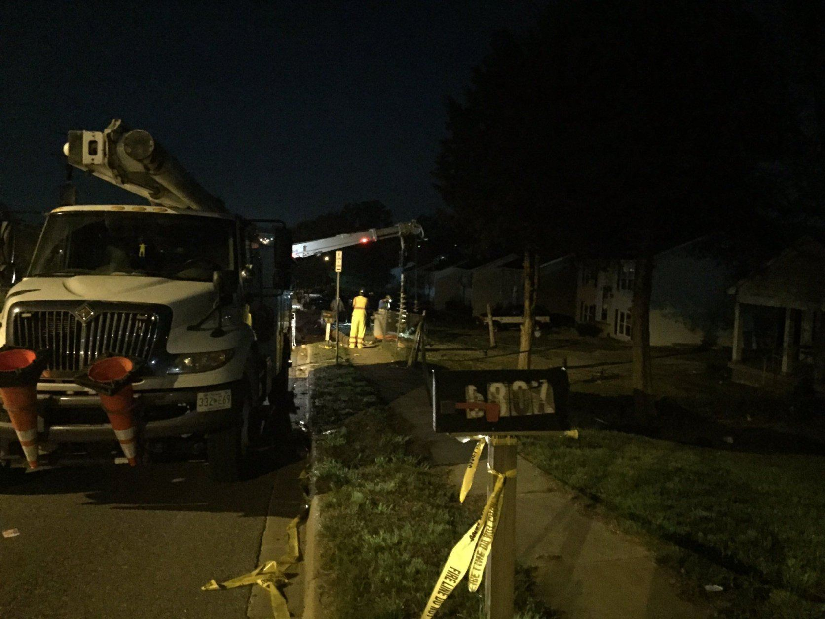 Pepco crews work to put in a new utility pole after a fatal crash in Prince George's County. (WTOP/John Domen)