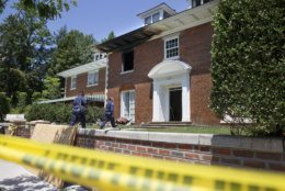 FILE - In this May 22, 2015 file photo, police continue working at a fire-damaged multimillion-dollar home in northwest Washington home where 46-year-old Savvas Savopoulos, his 47-year-old wife, Amy Savopoulos, the couple's 10-year-old son Philip, and housekeeper Veralicia Figueroa were found dead May 14. The mansion where three members of a wealthy Washington family and their housekeeper were slain is on the market. The 5-bedroom manor-style home with a 2-car garage in upper northwest Washington was listed last week for $3.25 million. (AP Photo/Jacquelyn Martin, File)