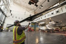 The Lockheed Martin/Boeing RQ-3A DarkStar aircraft is lowered in the Military Unmanned Aerial Vehicles exhibit during west end renovation of the National Air and Space Museum in Washington, DC, March 7, 2019. (Smithsonian photo by Jim Preston)  Material is subject to Smithsonian Terms of Use. Should you wish to use National Air and Space material in any medium, please submit an Application for Permission to Reproduce NASM Material, available at:  https://airandspace.si.edu/permissions
