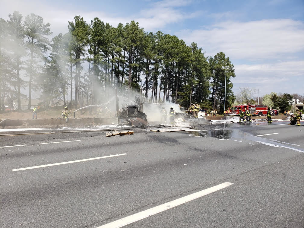 Fire crews extinguish Thursday afternoon's fire on the Capital Beltway in Virginia. (Courtesy Virginia State Police)