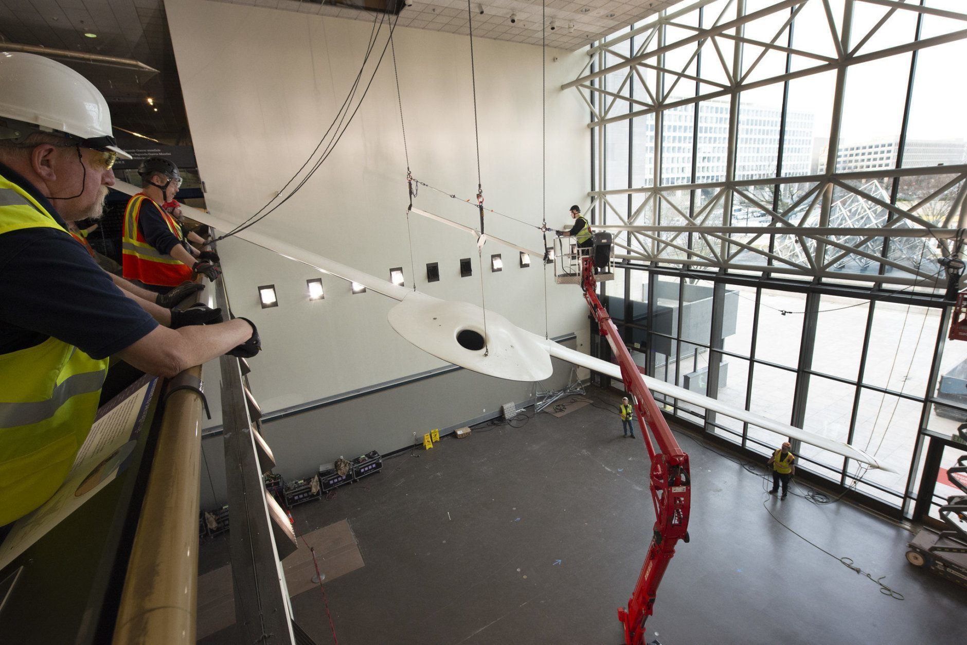 The Lockheed Martin/Boeing RQ-3A DarkStar drone is lowered in the Military Unmanned Aerial Vehicles exhibit during west end renovation of the National Air and Space Museum in Washington, DC, March 7, 2019. (Smithsonian photo by Mark Avino/Courtesy Smithsonian's National Air and Space Museum)