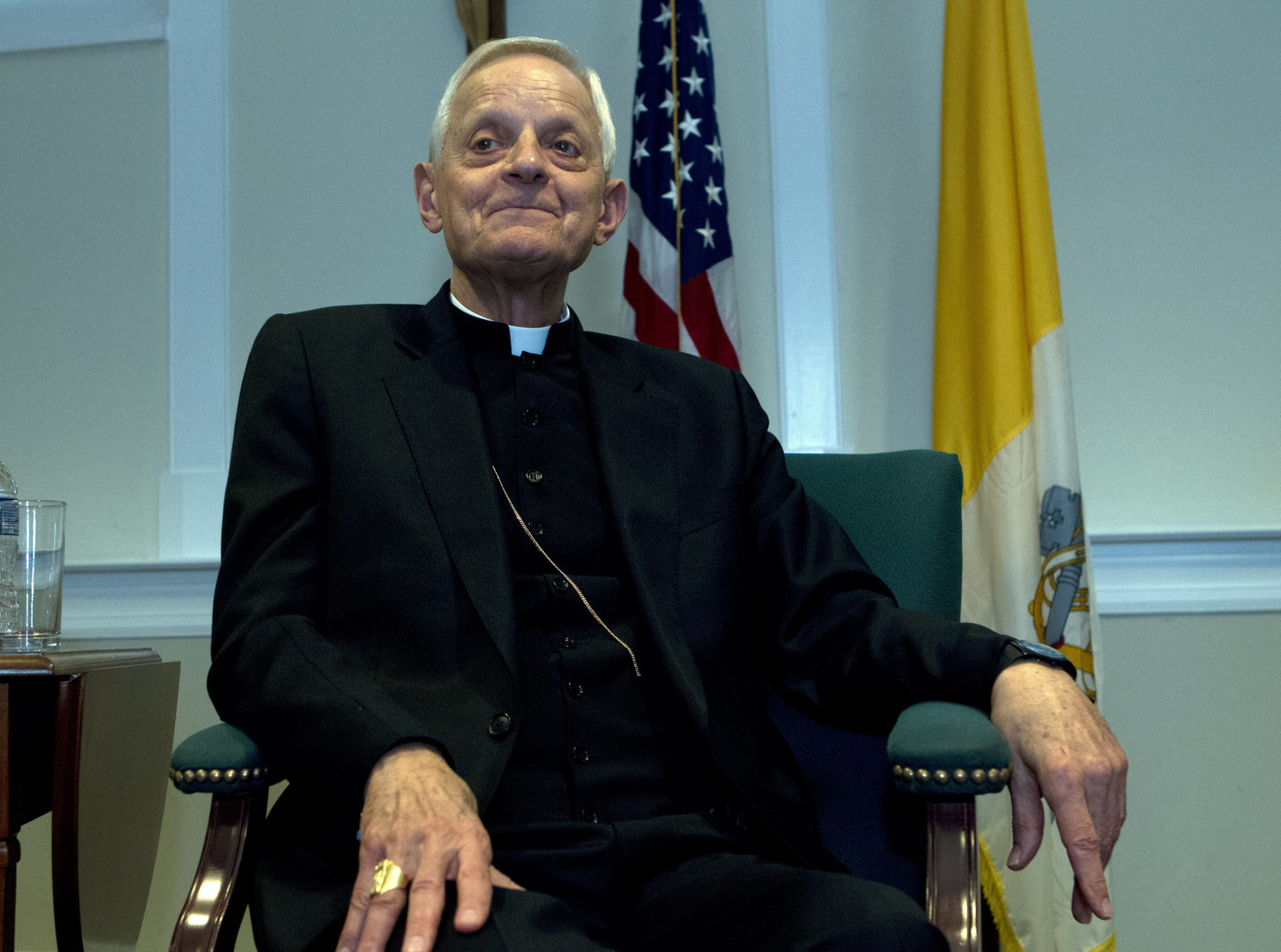 Cardinal Donald Wuerl listens as Archbishop designated by Pope Francis to the Archdiocese of Washington, Archbishop Wilton D. Gregory, speaks during a news conference at Washington Archdiocesan Pastoral Center in Hyattsville, Md., Thursday, April 4, 2019. Archbishop-designate Gregory will succeed Cardinal Donald Wuerl. (AP Photo/Jose Luis Magana)