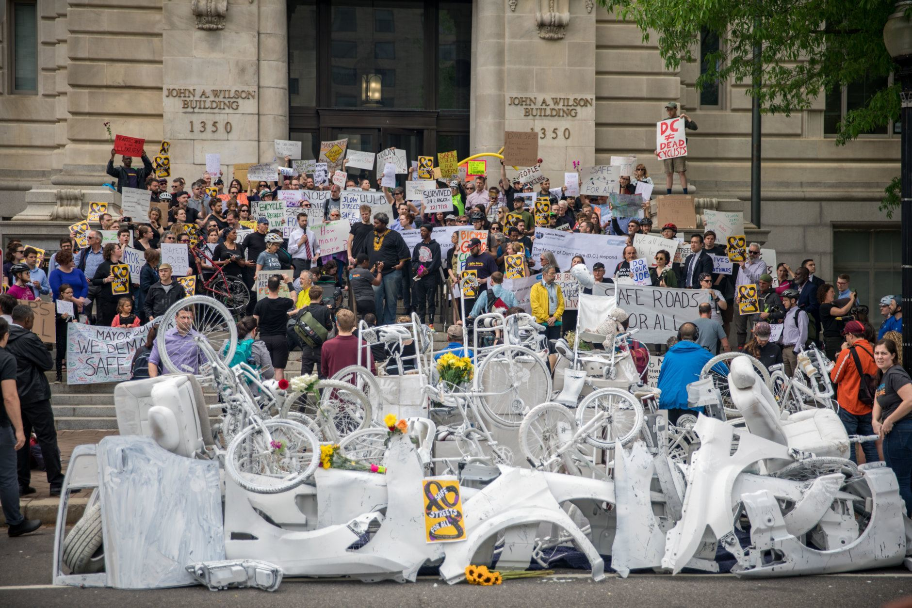 Protesters in front of the Wilson Building say Mayor Bowser needs to do more for safe streets in DC. (Courtesy Aimee Custis/Aimee Custis Photography)