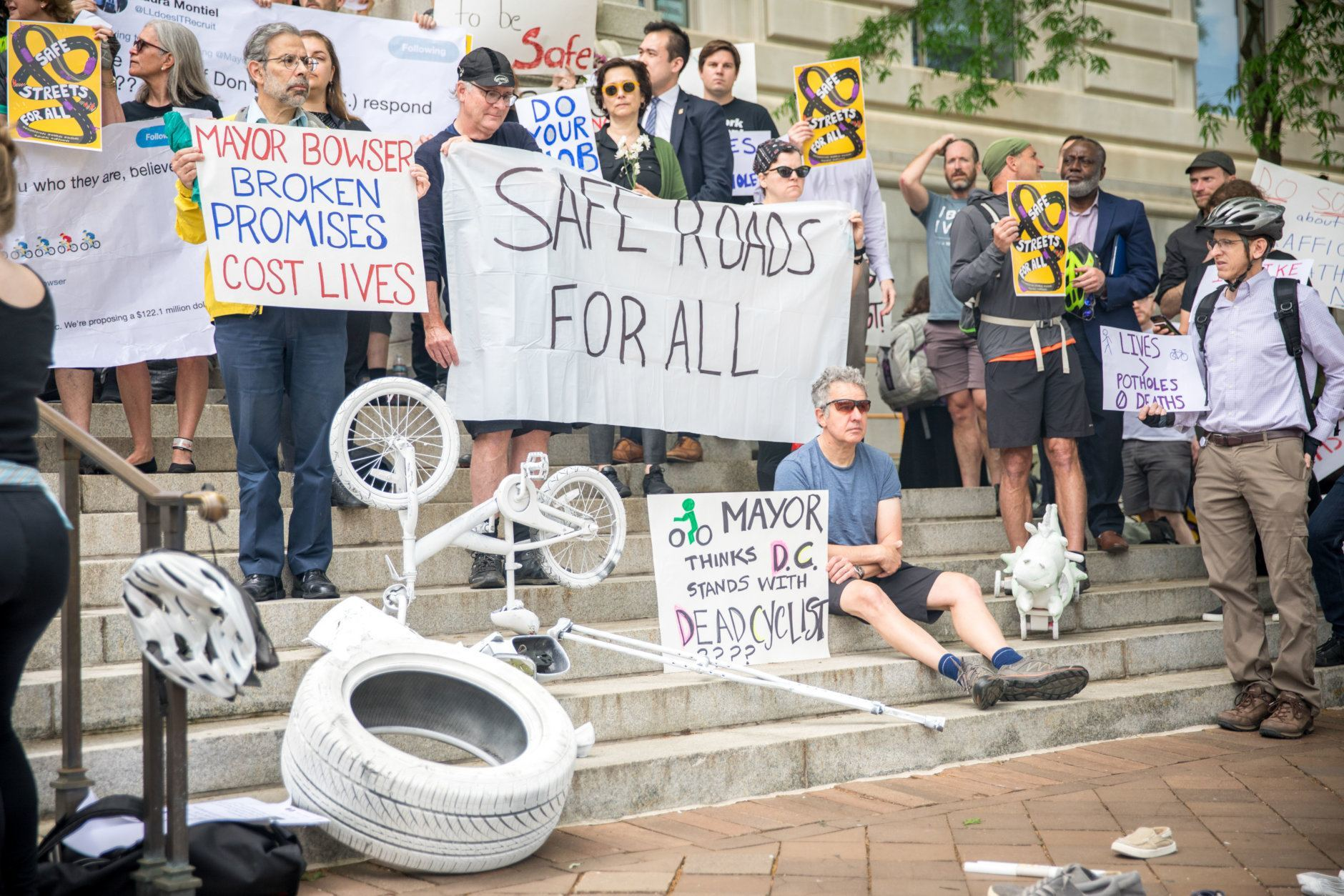 Protesters in front of the Wilson Building at Friday afternoon's demonstration for safe streets. (Courtesy Aimee Custis/Aimee Custis Photography)