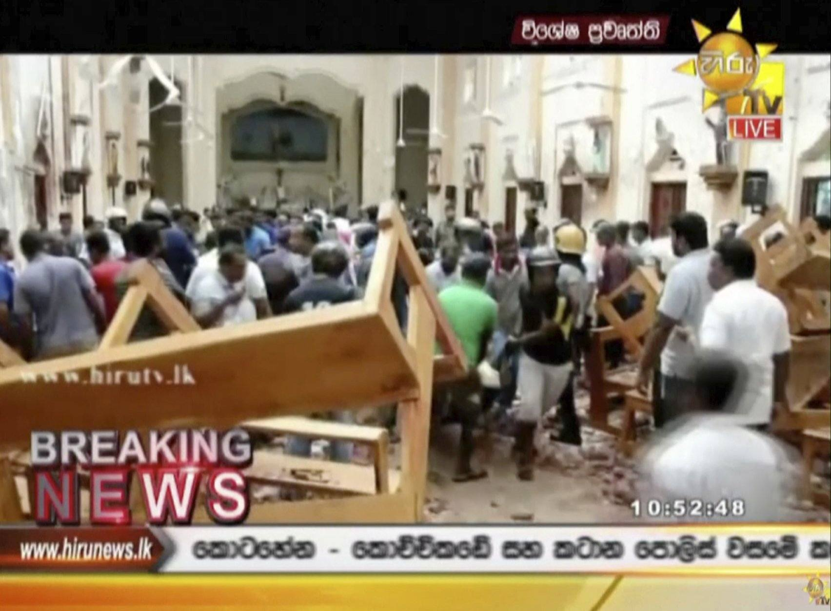 ADDS DETAIL OF THE PLACE - This image made from video provided by Hiru TV shows damage inside St. Anthony's Shrine after a blast in Colombo, Sunday, April 21, 2019. Near simultaneous blasts rocked three churches and three hotels in Sri Lanka on Easter Sunday. (Hiru TV via AP)