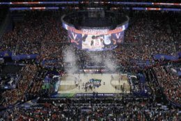 Virginia players celebrates after defeating Texas Tech 85-77 in the overtime in the championship of the Final Four NCAA college basketball tournament, Monday, April 8, 2019, in Minneapolis. (AP Photo/Morry Gash)