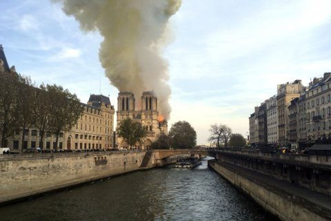 The Latest: American tourists shocked at Notre Dame fire