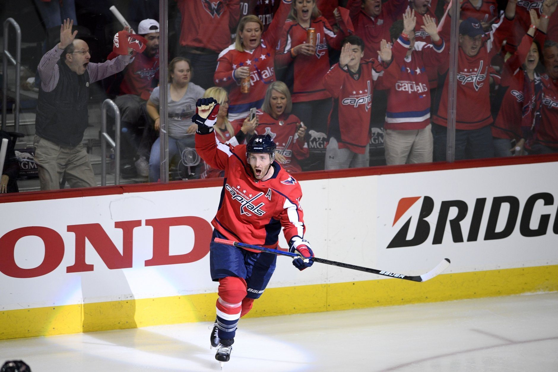 Washington Capitals defenseman Brooks Orpik (44) celebrates his game-winning goal in overtime of Game 2 of an NHL hockey first-round playoff series against the Carolina Hurricanes, Saturday, April 13, 2019, in Washington. The Capitals won 4-3 in overtime. (AP Photo/Nick Wass)