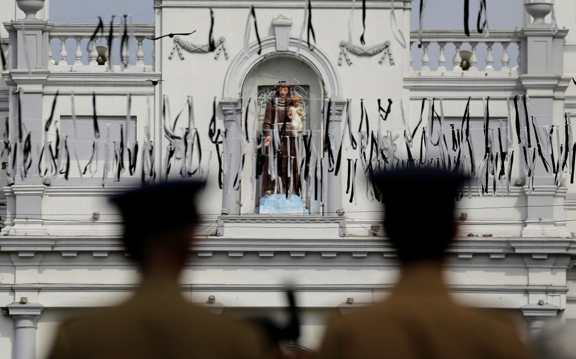 Sri Lankan police officers secure the area of exploded St. Anthony's Church on Easter Sunday attacks in Colombo, Sri Lanka, Sunday, April 28, 2019. Sri Lanka's Catholics on Sunday awoke preparing to celebrate Mass in their homes by a televised broadcast as churches across the island shut over fears of militant attacks, a week after the Islamic State-claimed Easter suicide bombings. (AP Photo/Eranga Jayawardena)