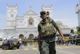 Sri Lankan Army soldiers secure the area around St. Anthony's Shrine after a blast in Colombo, Sri Lanka, Sunday, April 21, 2019. More than two hundred people were killed and hundreds more injured in eight blasts that rocked churches and hotels in and just outside Sri Lanka's capital on Easter Sunday. (AP Photo/Eranga Jayawardena)