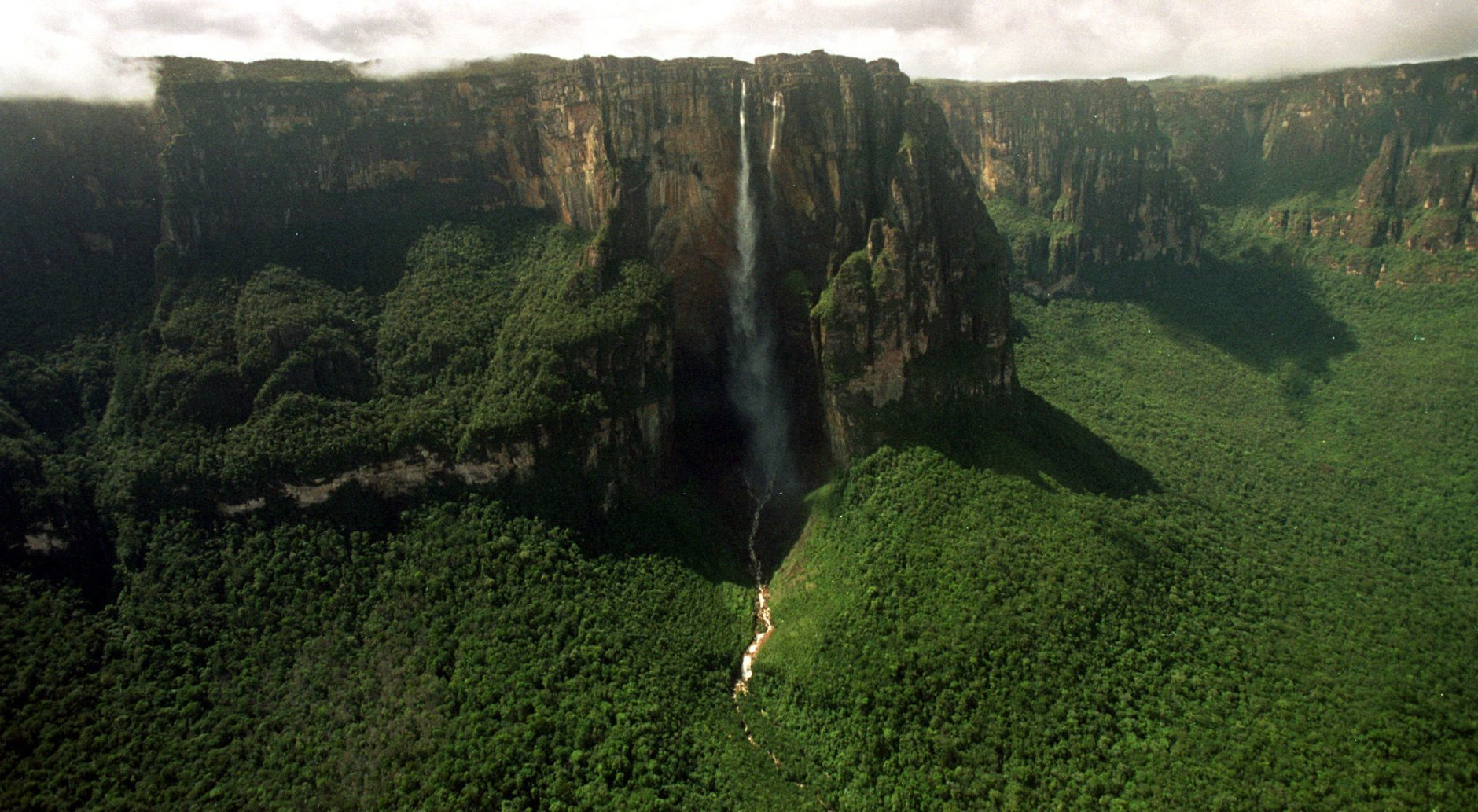 "The worlds highest waterfall Angel Falls, locally known as Parekupa-meru, 15 times taller than Niagara Falls at 3,212 feet, is seen in Canaima National Park, Venezuela, Jan. 13, 2004. The mesas inspired Sir Arthur Conan Doyle's novel, ""The Lost World,"" in which dinosaurs live on an isolated plateau in the Amazon. (AP Photo/Leslie Mazoch)"