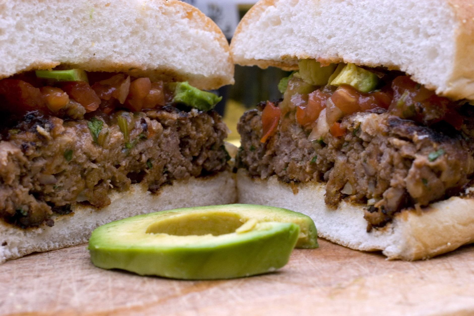 ** FOR USE WITH AP LIFESTYLES ** Salsa and avocado top a Smokey Beef and Black Bean Burger in this Aug. 22, 2007 photo. Some healthful ingredients easily mixed into 85 percent lean ground beef enhance the flavor while reducing the amount of meat (and fat) in each burger. (AP Photo/Larry Crowe)