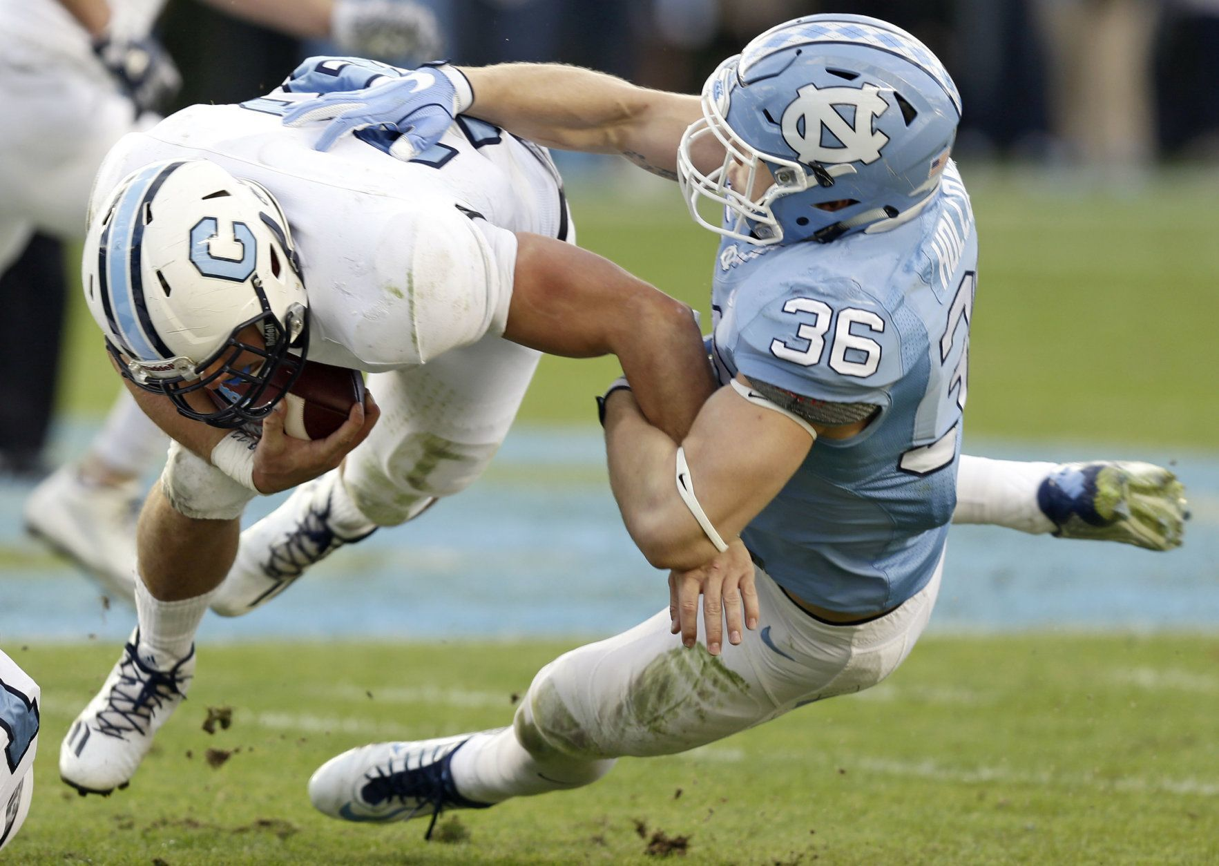 North Carolina's Cole Holcomb (36) tackles The Citadel's Tyler Renew during the first half of an NCAA college football game in Chapel Hill, N.C., Saturday, Nov. 19, 2016. (AP Photo/Gerry Broome)