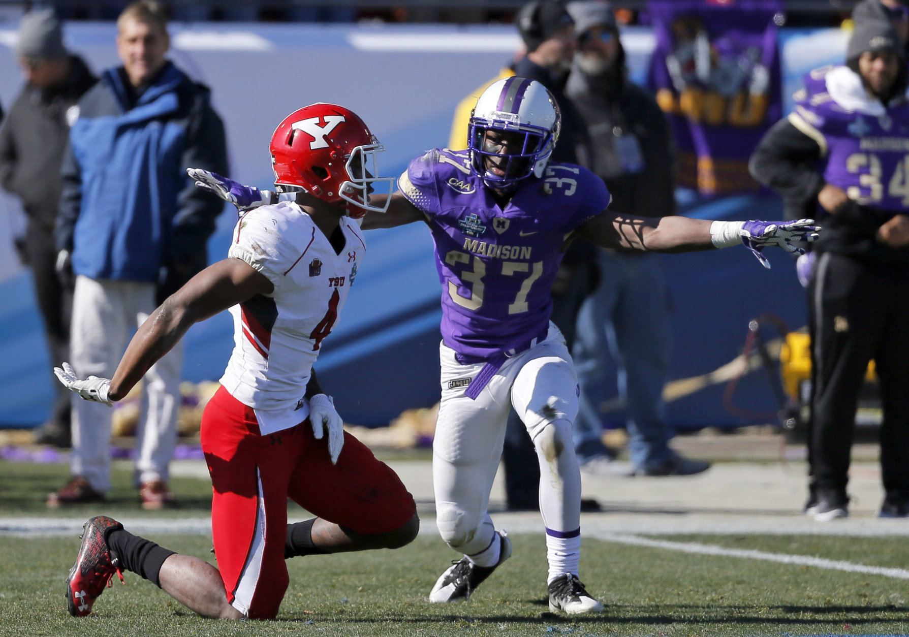 James Madison cornerback Jimmy Moreland (37) celebrates after breaking up a pass intended for Youngstown State wide receiver Damoun Patterson (4) in the first half of the FCS championship NCAA college football game, Saturday, Jan. 7, 2017, in Frisco, Texas. (AP Photo/Tony Gutierrez)