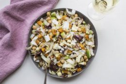 This November 2017 photo shows a chopped winter salad in New York. This dish is from a recipe by Katie Workman. (Mia via AP)