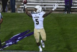 Akron linebacker Ulysees Gilbert III (5) celebrates after he picks up a loose ball for a touchdown against Northwestern during the second half of an NCAA college football game in Evanston, Ill., Saturday, Sept. 15, 2018. (AP Photo/Matt Marton)