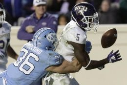 North Carolina's Cole Holcomb (36) hits Western Carolina's Connell Young (5) to cause a fumble during the second half of an NCAA college football game in Chapel Hill, N.C., Saturday, Nov. 17, 2018. North Carolina won 49-26. (AP Photo/Gerry Broome)