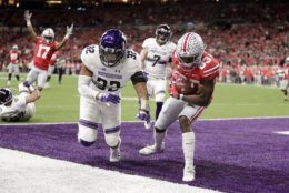 Ohio State's Terry McLaurin (83) makes a touchdown reception against Northwestern's Nate Hall (32) during the first half of the Big Ten championship NCAA college football game, Saturday, Dec. 1, 2018, in Indianapolis. (AP Photo/Michael Conroy)