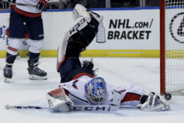 The puck gets past Washington Capitals goaltender Pheonix Copley for a goal scored by Florida Panthers right wing Troy Brouwer during the second period of an NHL hockey game, Monday, April 1, 2019, in Sunrise, Fla. (AP Photo/Lynne Sladky)