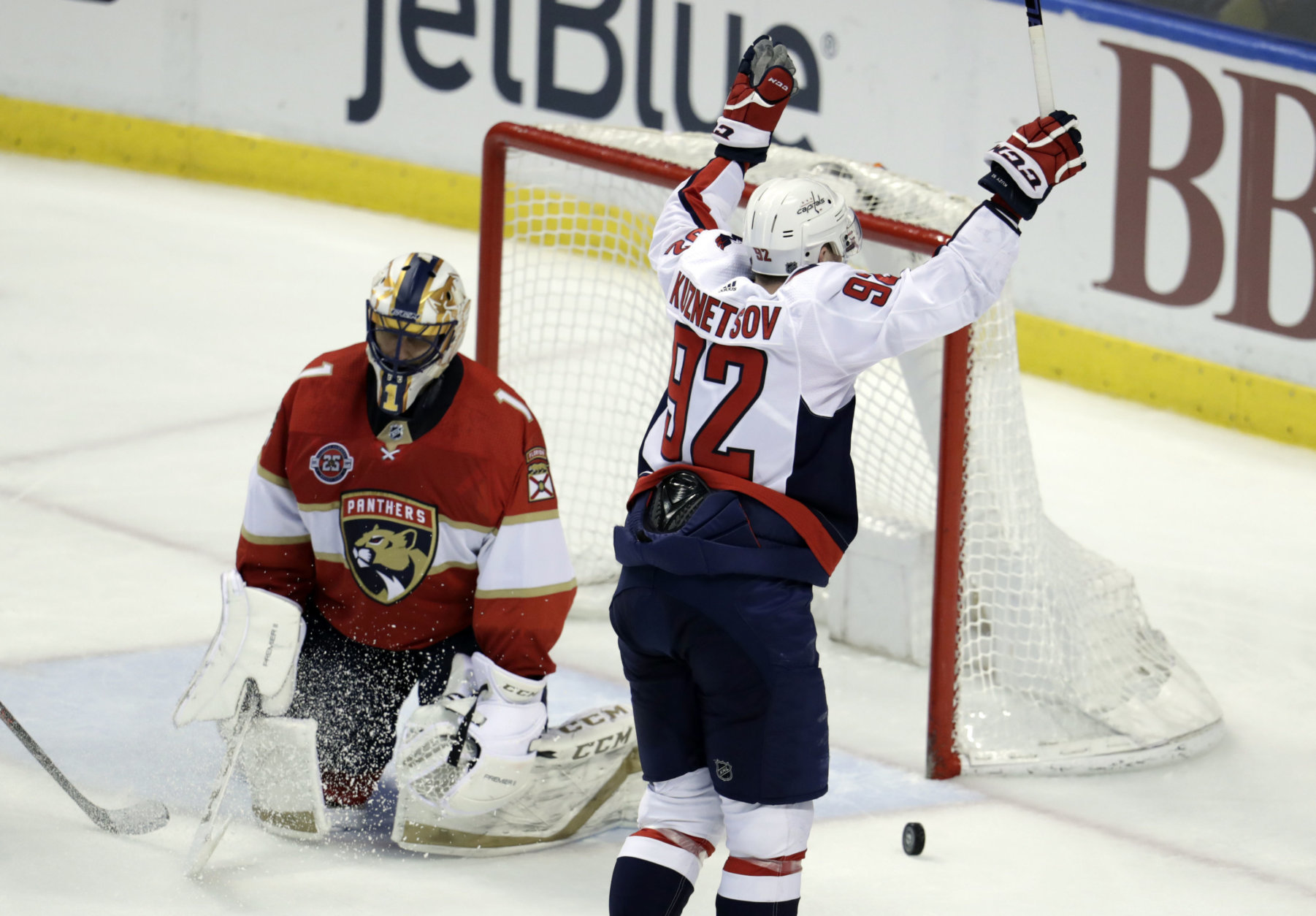 Washington Capitals center Evgeny Kuznetsov (92) celebrates after scoring a goal against Florida Panthers goaltender Roberto Luongo (1) during the third period of an NHL hockey game, Monday, April 1, 2019, in Sunrise, Fla. (AP Photo/Lynne Sladky)