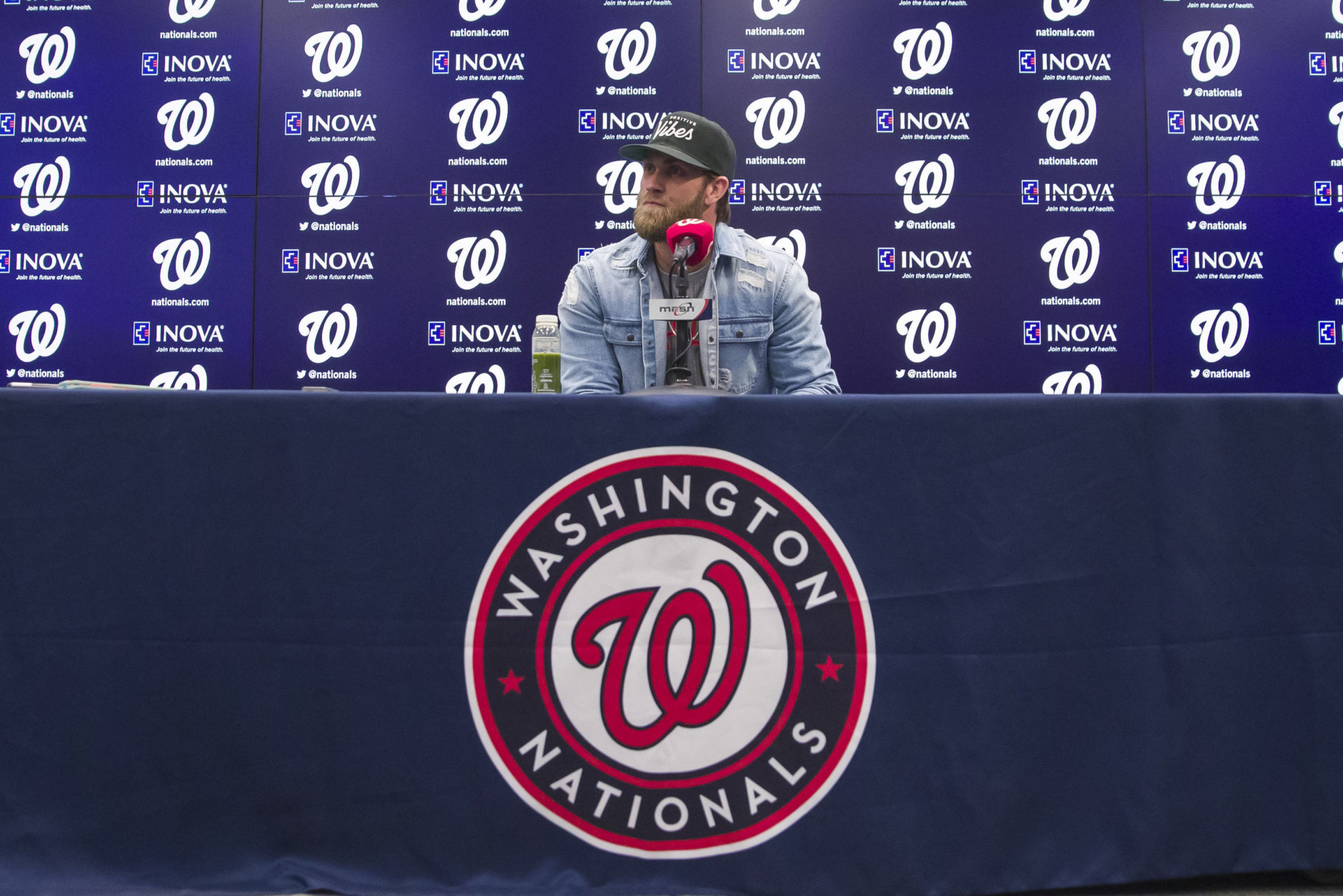Philadelphia Phillies' Bryce Harper pauses while speaking during a news conference before a baseball game against the Washington Nationals at Nationals Park, Tuesday, April 2, 2019, in Washington. (AP Photo/Alex Brandon)