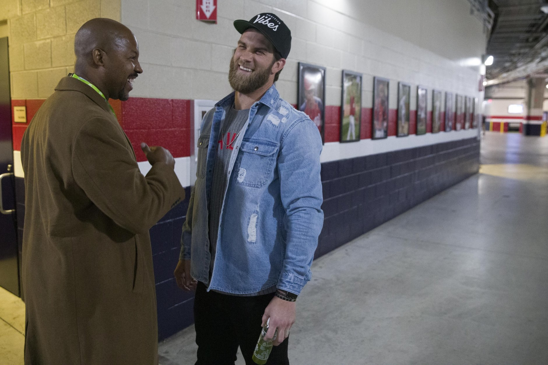 MASN baseball analyst and former Houston Astros manager Bo Porter, left, talks with Philadelphia Phillies' Bryce Harper after a news conference before a baseball game against the Washington Nationals at Nationals Park, Tuesday, April 2, 2019, in Washington. (AP Photo/Alex Brandon)