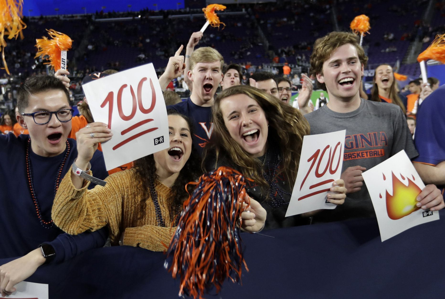 Virginia fans cheer before a semifinal round game against Auburn at the Final Four NCAA college basketball tournament, Saturday, April 6, 2019, in Minneapolis. (AP Photo/David J. Phillip)