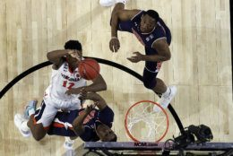 Virginia's De'Andre Hunter (12) takes a shot against Auburn's Horace Spencer (0) during the second half in the semifinals of the Final Four NCAA college basketball tournament, Saturday, April 6, 2019, in Minneapolis. (AP Photo/David J. Phillip)