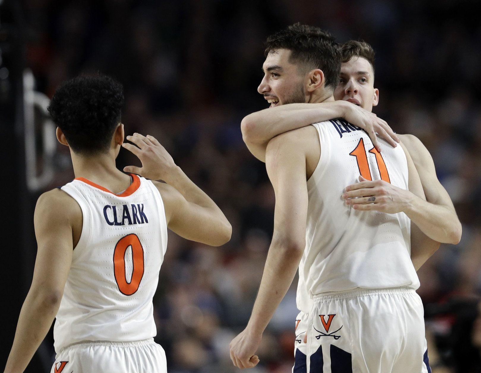 Virginia's Kihei Clark (0), Ty Jerome (11) and Kyle Guy react during the second half in the semifinals of the Final Four NCAA college basketball tournament against Auburn, Saturday, April 6, 2019, in Minneapolis. (AP Photo/David J. Phillip)