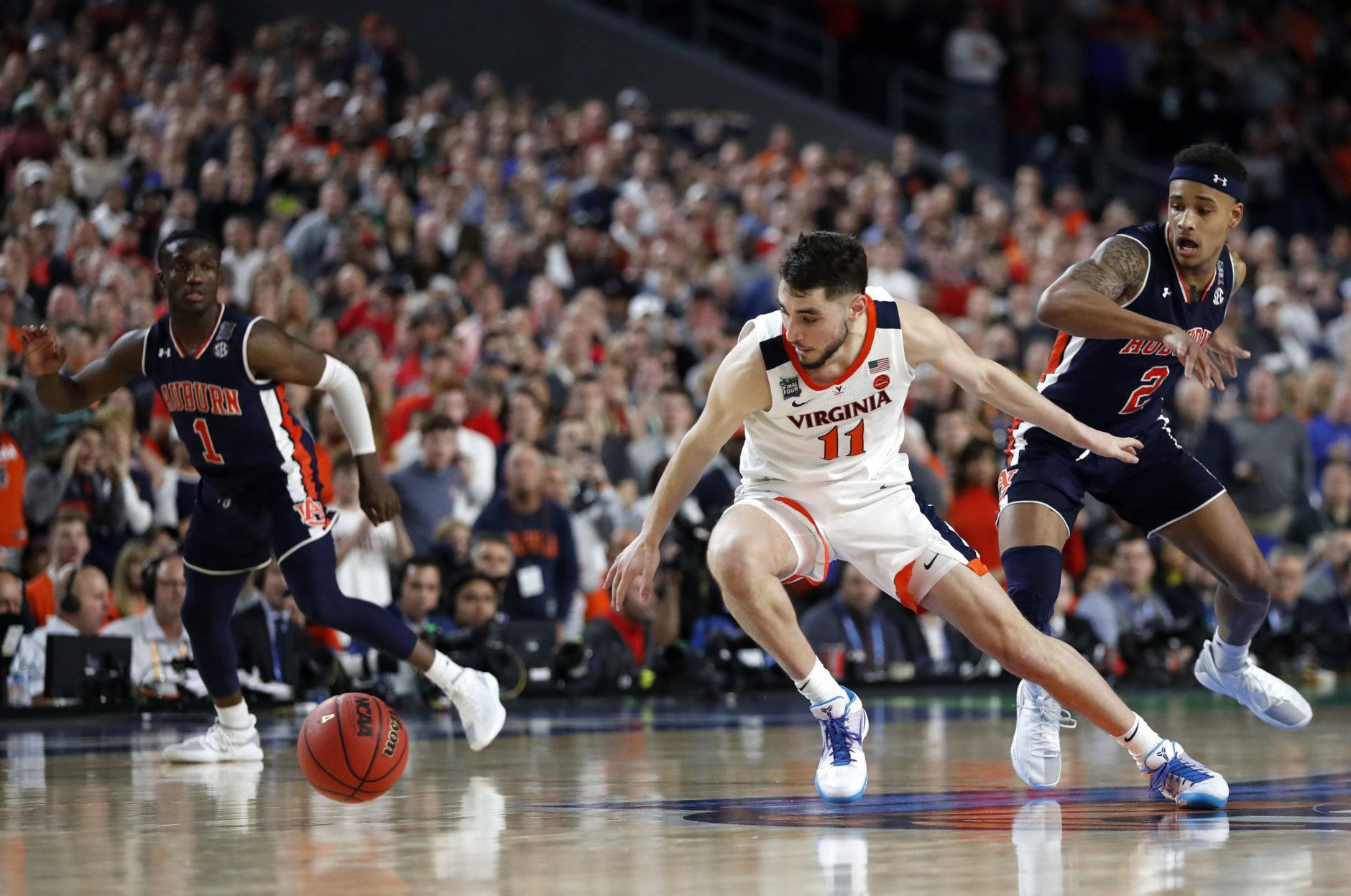 Virginia guard Ty Jerome (11) runs down a loose ball ahead of Auburn guard Bryce Brown, right, during the second half in the semifinals of the Final Four NCAA college basketball tournament, Saturday, April 6, 2019, in Minneapolis. (AP Photo/Jeff Roberson)
