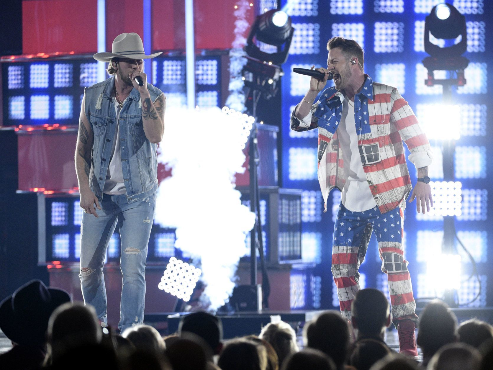 """Brian Kelley, left, and Tyler Hubbard, of Florida Georgia Line, perform """"Can't Hide Red"""" at the 54th annual Academy of Country Music Awards at the MGM Grand Garden Arena on Sunday, April 7, 2019, in Las Vegas. (Photo by Chris Pizzello/Invision/AP)"""