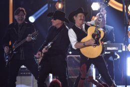 """Kix Brooks, right, of Brooks & Dunn, performs """"Brand New Man"""" at the 54th annual Academy of Country Music Awards at the MGM Grand Garden Arena on Sunday, April 7, 2019, in Las Vegas. (Photo by Chris Pizzello/Invision/AP)"""