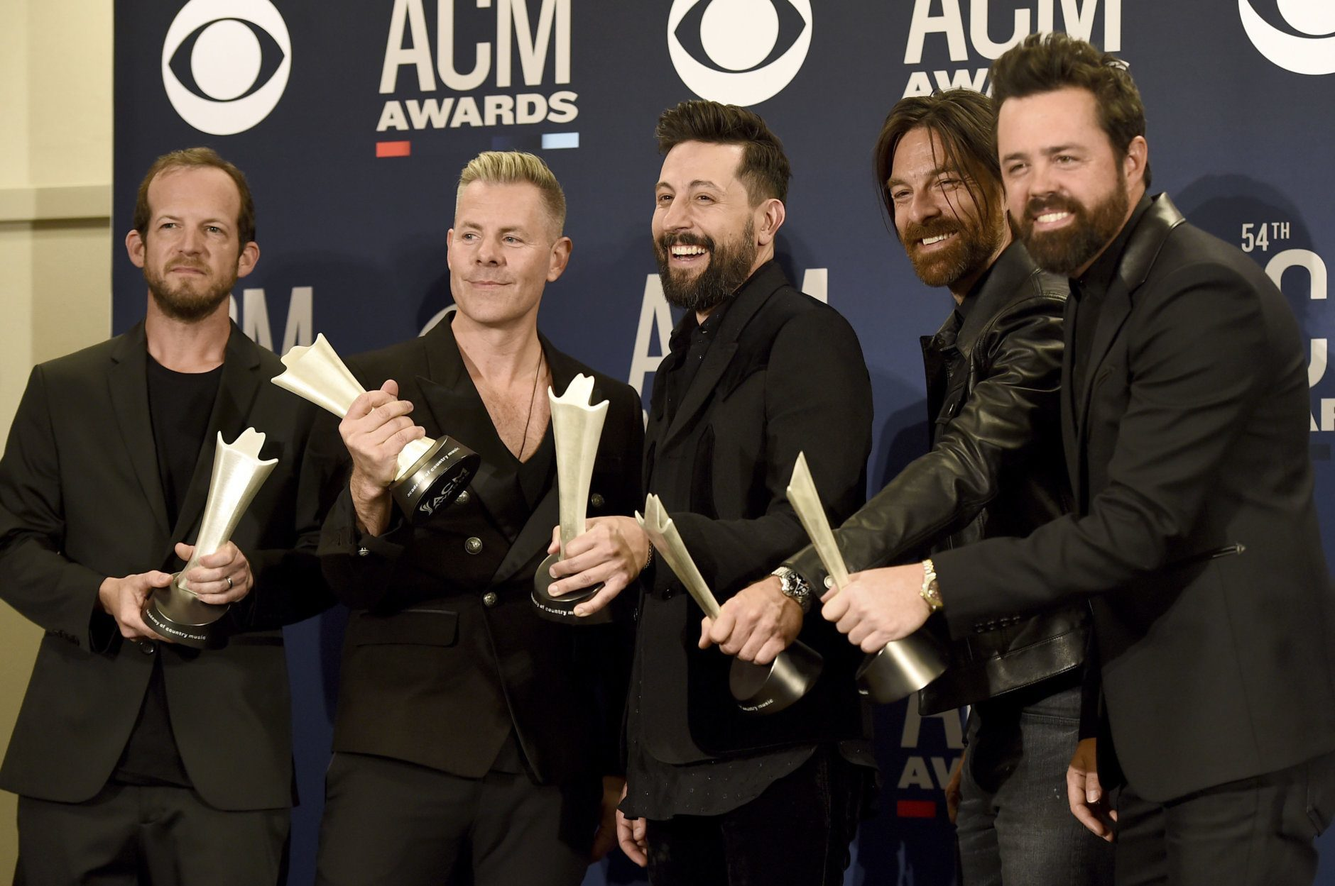 Whit Sellers, from left, Trevor Rosen, Matthew Ramsey, Geoff Sprung and Brad Tursi, of Old Dominion, pose in the press room with the award for group of the year at the 54th annual Academy of Country Music Awards at the MGM Grand Garden Arena on Sunday, April 7, 2019, in Las Vegas. (Photo by Jordan Strauss/Invision/AP)