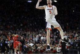 Virginia's Kyle Guy (5) celebrates after defeating Texas Tech 85-77 in the overtime in the championship of the Final Four NCAA college basketball tournament, Monday, April 8, 2019, in Minneapolis. (AP Photo/David J. Phillip)