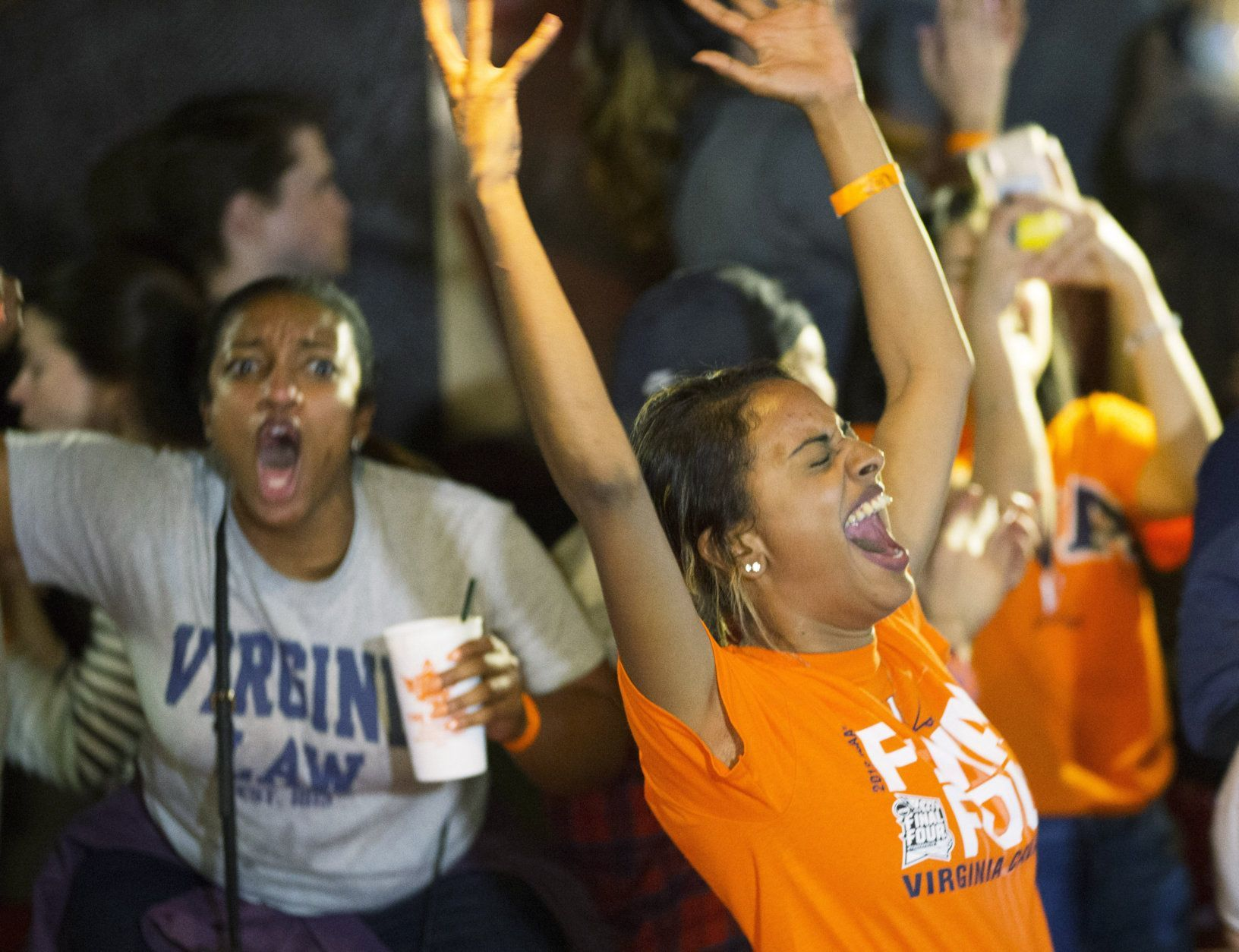 Virginia fans celebrate their teams win of the championship of the Final Four NCAA college basketball tournament against Texas Tech, at a bar near the school in Richmond, Va., Monday, April 8, 2019. (AP Photo/Steve Helber)