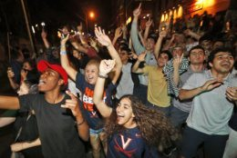 Virginia fans celebrate their team's win in the championship of the Final Four NCAA college basketball tournament against Texas Tech Monday, April 8, 2019. (AP Photo/Steve Helber)
