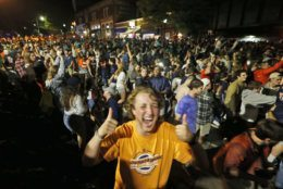 Virginia fans celebrate their team's win in the championship of the Final Four NCAA college basketball tournament against Texas Tech, at an intersection near the school in Richmond, Va., Monday, April 8, 2019. (AP Photo/Steve Helber)