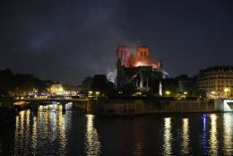 Notre Dame cathedral is seen burning in Paris, Monday, April 15, 2019. A catastrophic fire engulfed the upper reaches of Paris' soaring Notre Dame Cathedral as it was undergoing renovations Monday, threatening one of the greatest architectural treasures of the Western world as tourists and Parisians looked on aghast from the streets below. (AP Photo/Francois Mori)