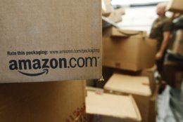 FILE - In this Oct. 18, 2010, file photo, an Amazon.com package awaits delivery from UPS in Palo Alto, Calif. Amazon, which hooked shoppers on getting just about anything delivered in two days, announced Thursday, April 25, 2019, that it will soon promise one-day delivery for its Prime members on most items. (AP Photo/Paul Sakuma, File)